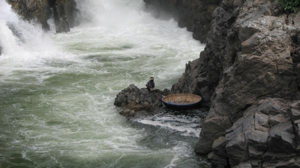 Boat man on rocks